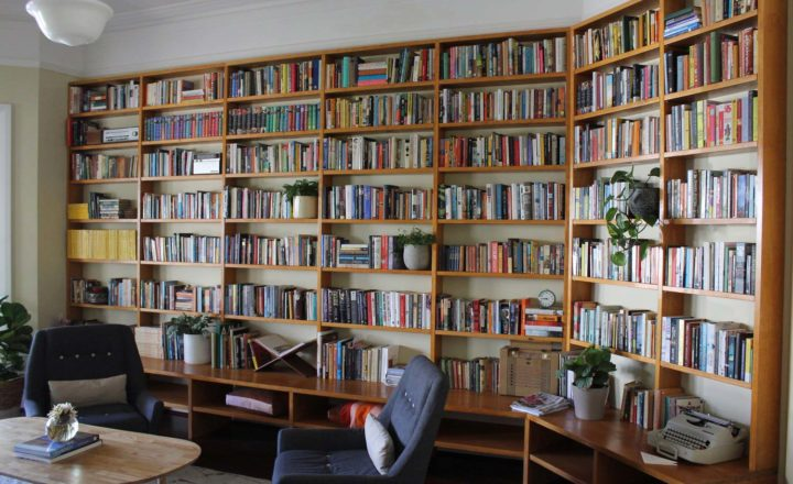 Room at the Centre for Stories featuring floor to ceiling book shelves.