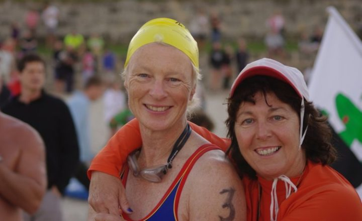Trish Dooey wearing swimming gear and smiling with a friend