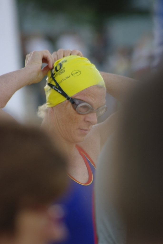 Trish preparing to swim. She is putting on her goggles.