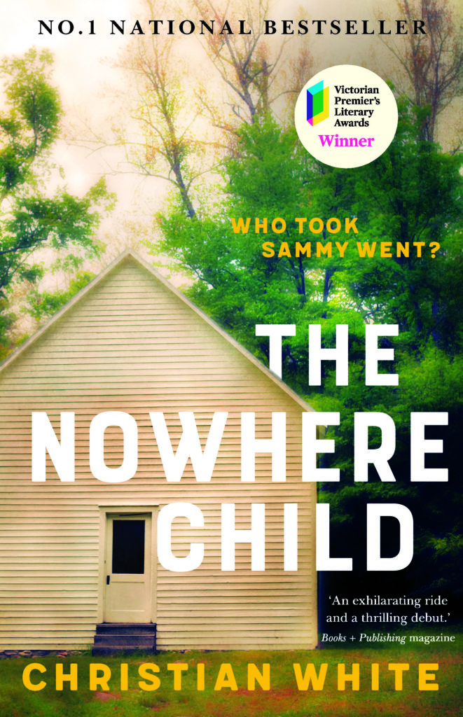 A book cover depicting a wodden house in the woods with the title 'The Nowhere Child'