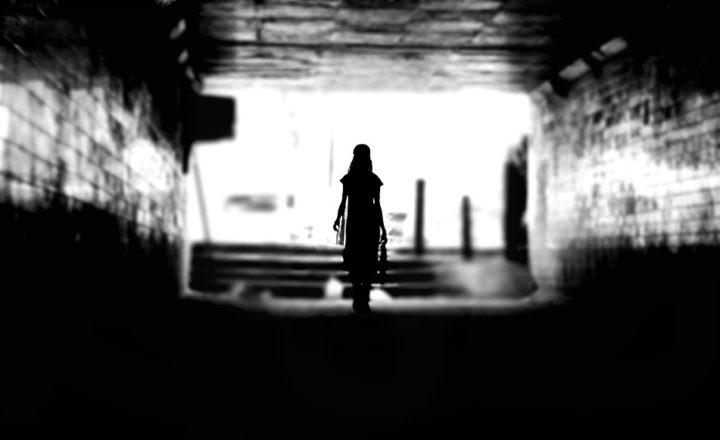 A woman walking through an urban setting
