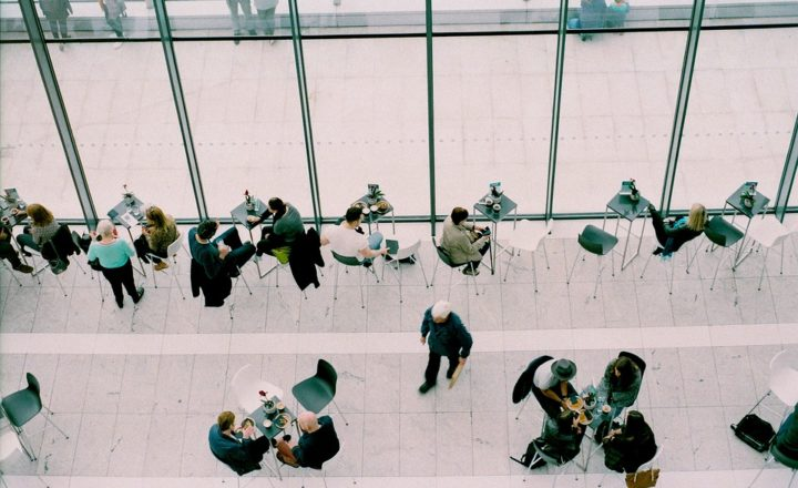 A bird's-eye-view of people in a corporate building