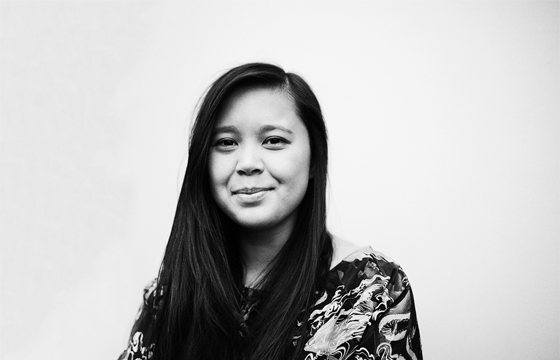A black and white portrait of Leah Jing McIntosh smiling.