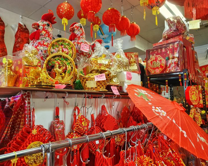 Photo of Chinese New Year paraphernalia such as parasols, lanterns and statues