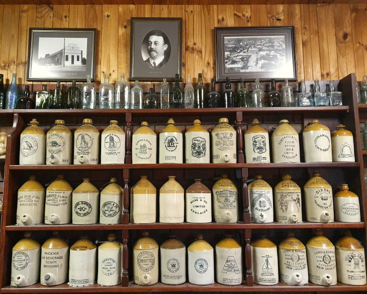 Collection of demijohns displayed on shelves