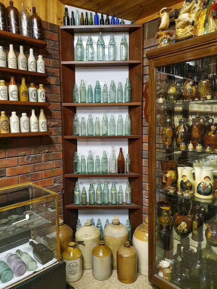 Collection of aerated bottles displayed on shelves