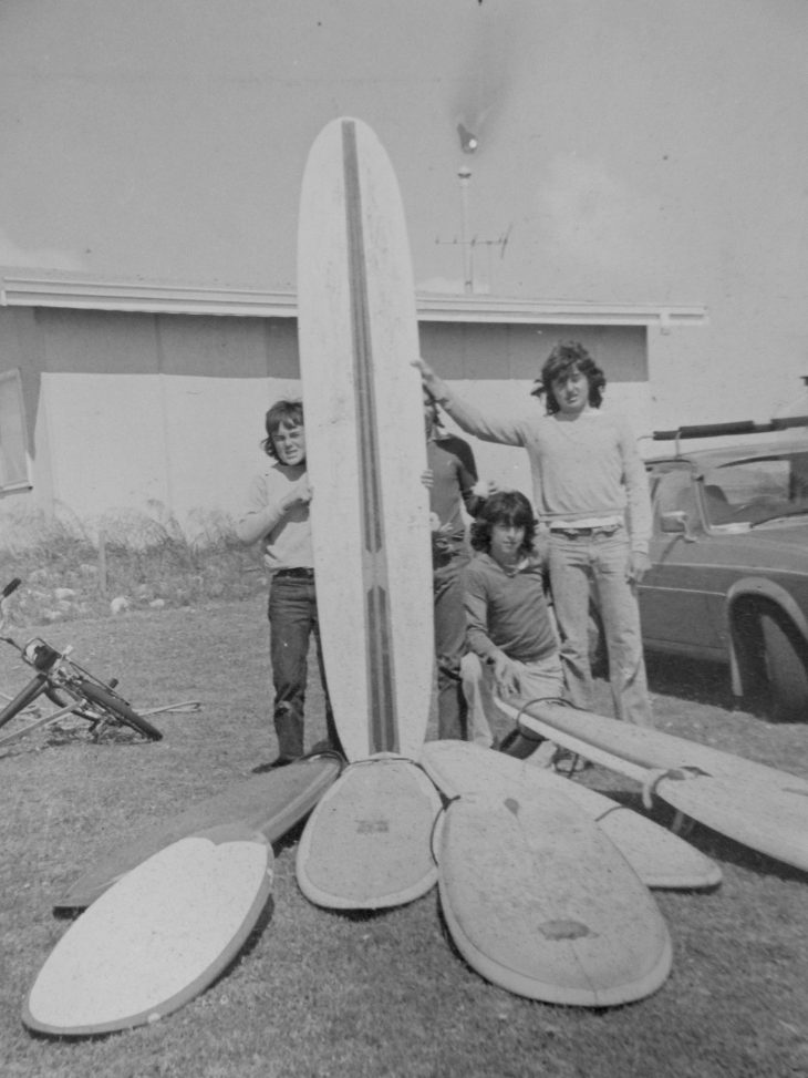 Old photo of Wayne Vinten and his friends holding surfboards in Falcon Bay
