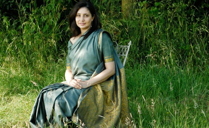 Photo of Kavita Jindal sitting on a chair in a grassy field