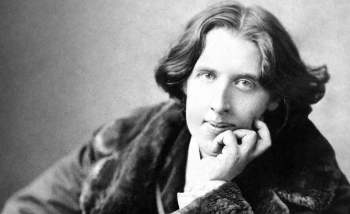 A black and white image of Oscar Wilde