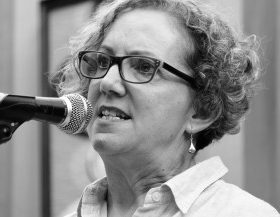 A black and white image of Josephine speaking into a microphone