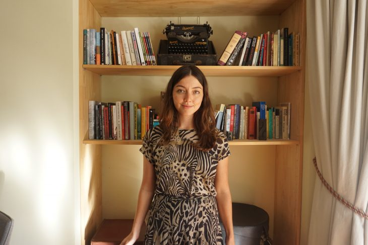 Sophie Raynor, social media marketing and communications extraordinare stands before a book shelf at the Centre for Stories looking poised and lovely. She is wearing a cool zebra-esque dress that she wears only at the Centre as a funky form of self-expression that is not accepted in many corporate jobs which is a shame because it looks lovely.