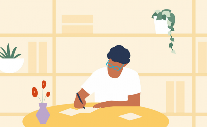 An illustration of a person working at a desk. They are sitting beside a pale yellow bookshelf that has many books and house plants perched on top.