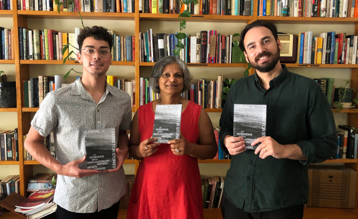 A picture of Jay Anderson, Caroline Wood and Robert Wood holding copies of LIMINAL x Centre for Stories