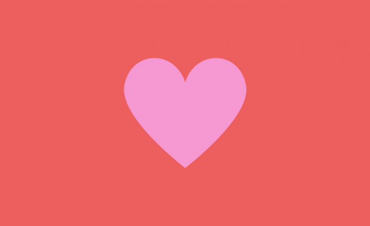 A bright pink heart on a bright red background