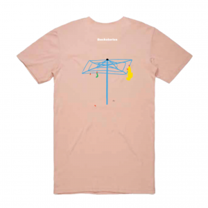 A photograph of a pale pink t-shirt. On the back of the shirt is a really cool illustration of a bright blue hills hoist with some washing on it. Above that, the iconic Backstories logo in white.