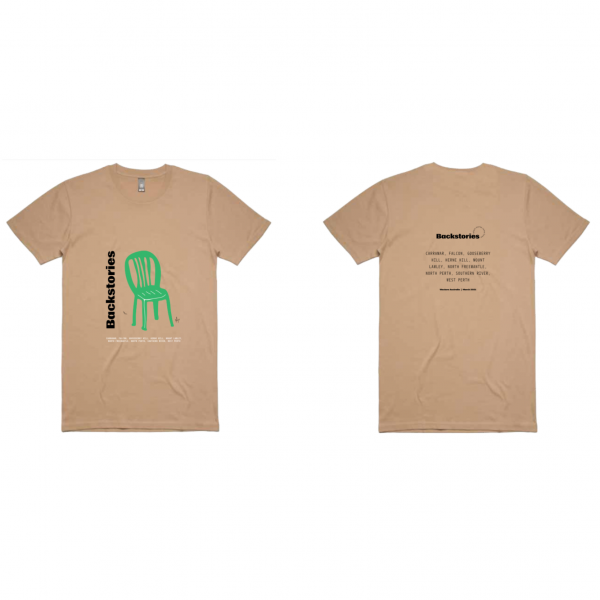 A photograph of a t-shirt. The t-shirt is a standard crew neck shirt in a brownish tan colour. On the front of the t-shirt is an illustration of a green deck chair. Along the side of the chair is the print 'Backstories' in black and bold groovy writing. Under the chair is a list of all of the suburbs that Backstories events are held.