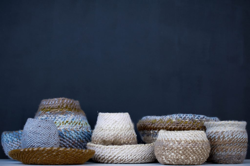 Photo of a group of small, woven baskets
