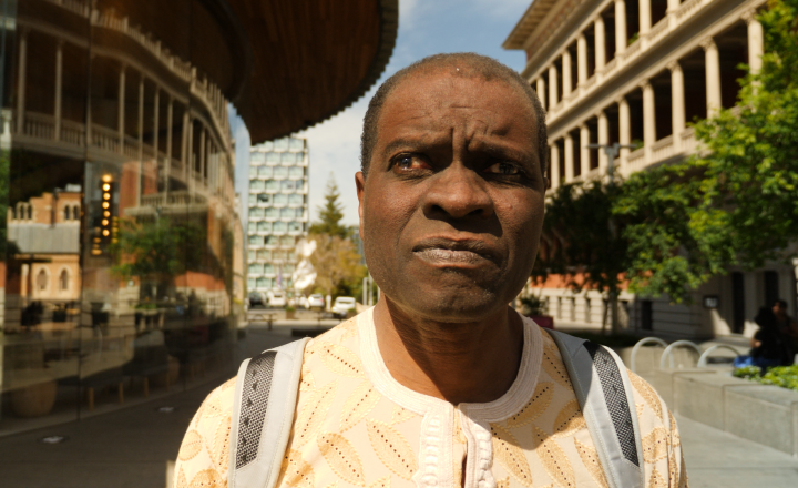 Photo of Segun Olowoyo standing outside the City of Perth Library